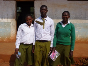 Photo of students who are in the Health Club at Makwema Secondary school, Kilolo, Tanzania: Clementina, Kizito and Sarah