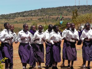Girls celebrating moving into their dormitory, Alexander Sauda School